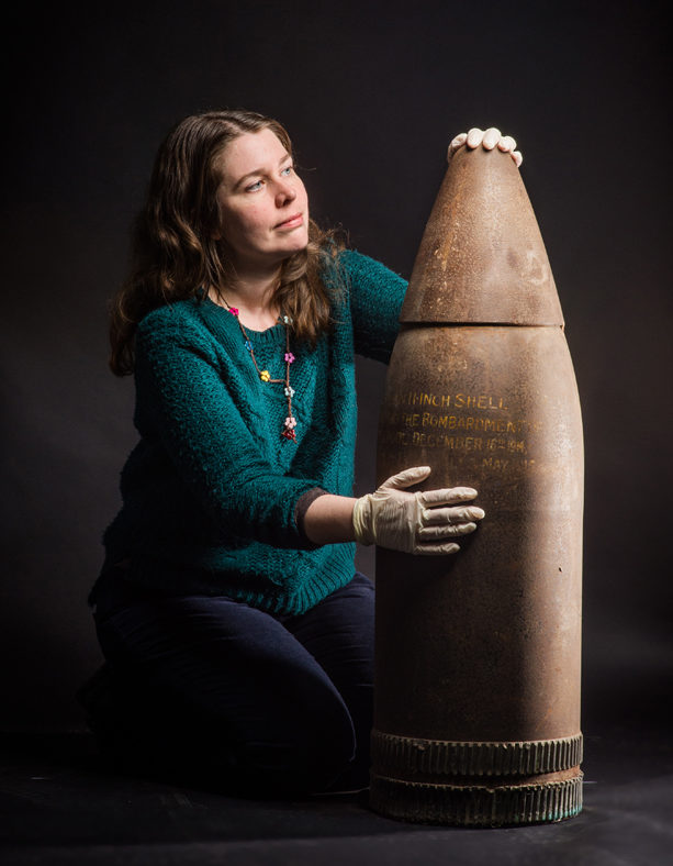 Curator Jenny Durrant with a First World War German artillery shell