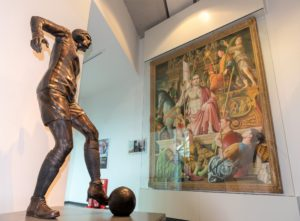 Bronze statue of Lily Parr, who played football in the 1920s, by sculptor Hannah Stewart, alongside a portrait of Eric Cantona, by Michael Browne